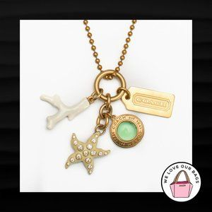 RARE! COACH OCEAN CHARM MIX STARFISH SNAPHEAD CORAL HANGTAG GOLD BRASS NECKLACE
